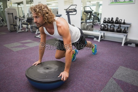 man doing crossfit fitness workout in