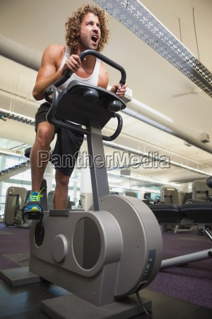 determined man working out on exercise