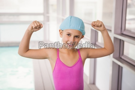 cute little girl flexing her arms