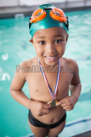 cute little boy with his medal