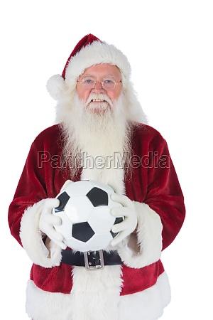 santa holds a classic football