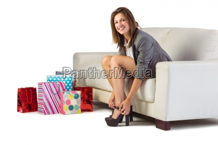 well dressed woman sitting on couch