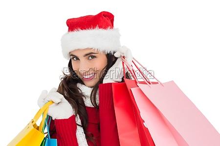festive brunette in winter wear holding
