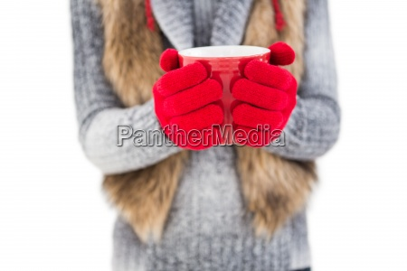 woman in winter clothes holding a