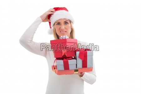 confused blonde in santa hat holding