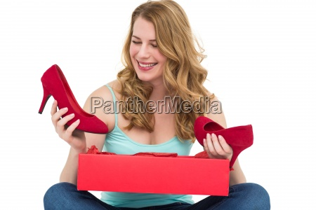 blonde woman discovering shoes in a