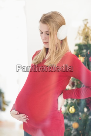 pretty pregnant woman caressing her belly