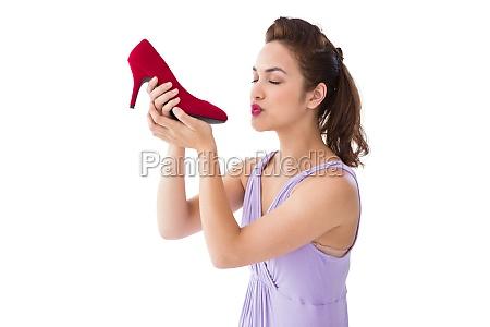 elegant brunette kissing a shoe