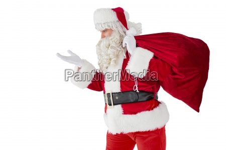 santa with hand out and holding