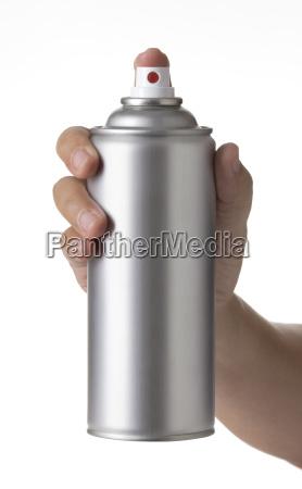 man hand spraying blank metal spray