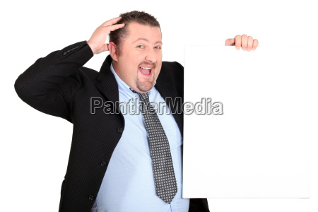 man in suit holding white panel