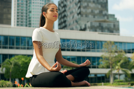 relax business woman yoga lotus position