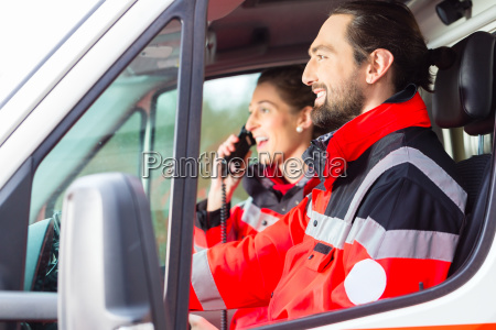 notartzt and paramedic driving ambulance