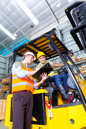 asian lift truck driver and foreman