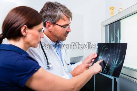 doctor with radiograph by hand of