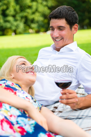 couple drinking red wine on the