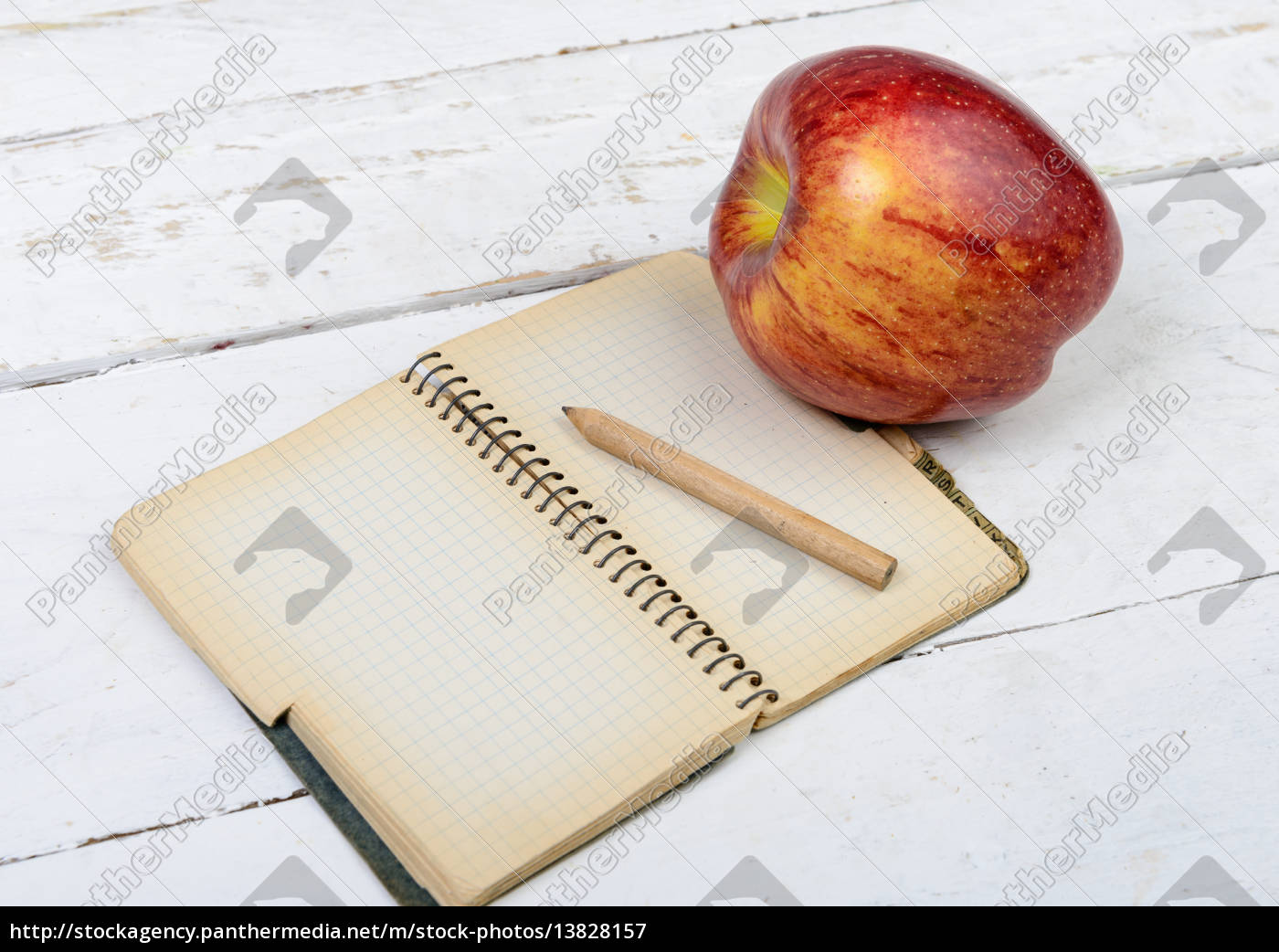 apple, and, notebook, on, a, table - 13828157