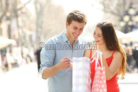 couple shopping and holding bags in