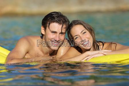 happy couple bathing on the beach