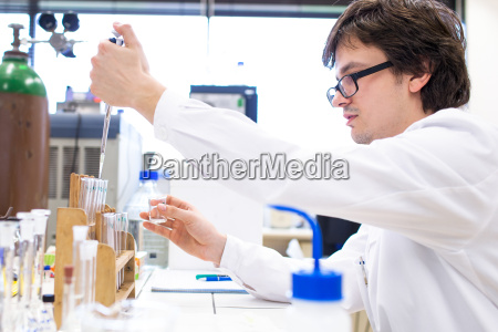 male researcher carrying out scientific research