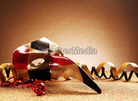 venetian masquerade mask on glittery table