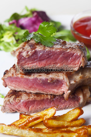 beef steak frites in slices with