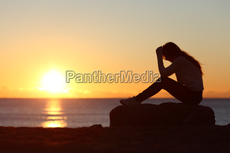 sad woman silhouette worried on the