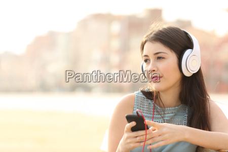 candid girl listening music with a