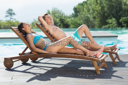 couple sitting on sun loungers by
