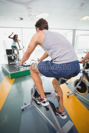 spin class working out with motivational