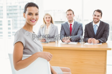 woman in front of corporate personnel