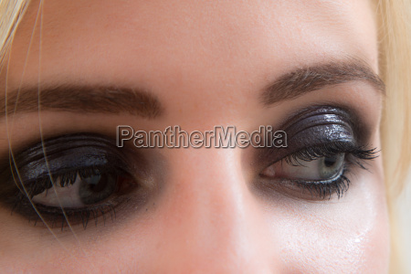 made up eyes of woman cosmetics