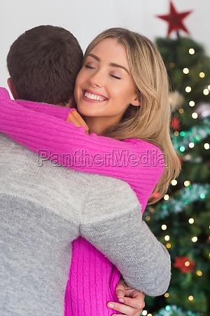 smiling woman hugging her boyfriend
