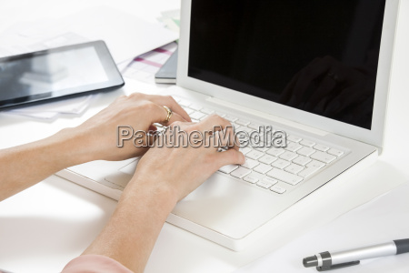 young businesswoman reading statistics at the