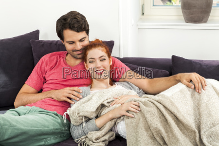 young lovers couple in the living