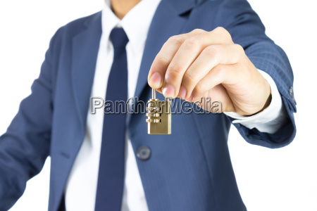 businessman hold brass combination lock isolated