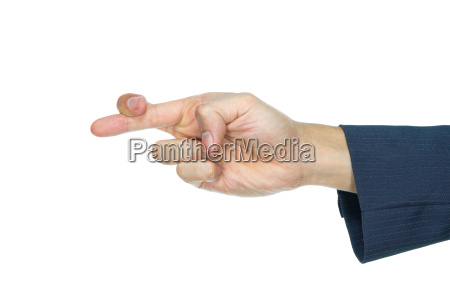 crossed fingers of businessman isolated on