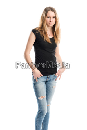 young girl in jeans looks serious