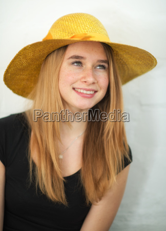 young blonde girl wearing a summer