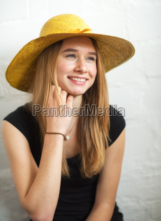 young blonde girl wearing a straw