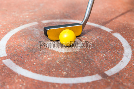 miniature golf club with ball at