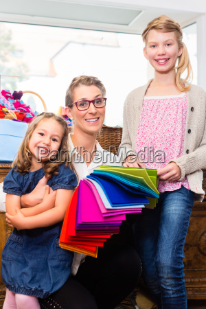 family buys craft supplies in a