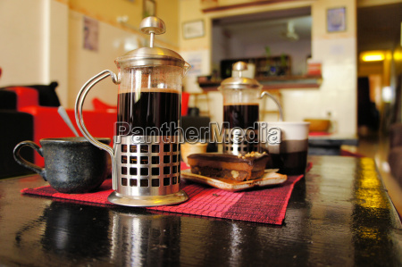 french press coffee maker with cup