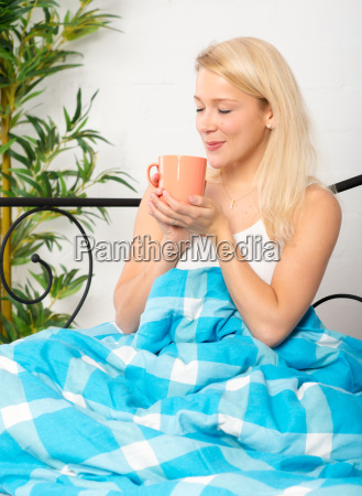 young woman enjoying a coffee in