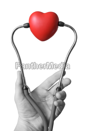 hand with stethoscope and heart