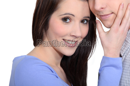 woman caressing a mans face