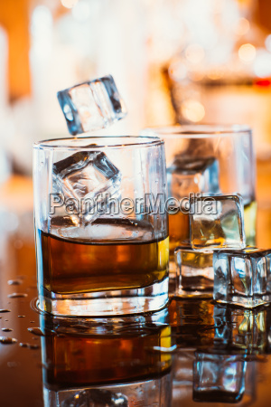 whiskey glass with ice and warm