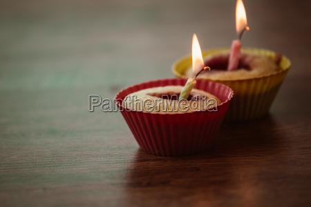 birthday banana muffin on wooden background
