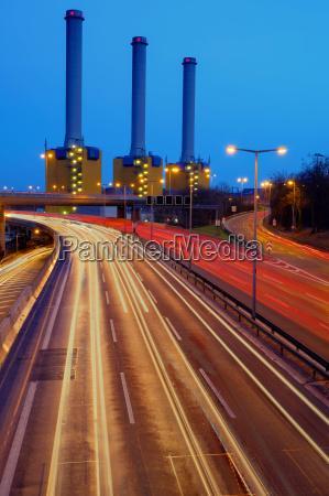 power plant behind the motorway in
