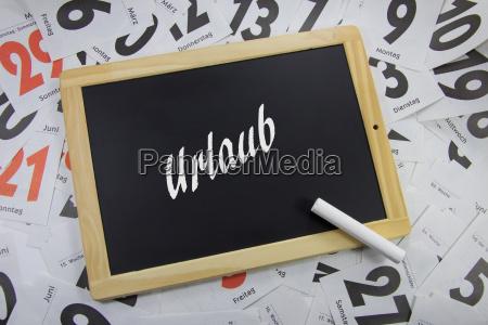 vacation written on a blackboard